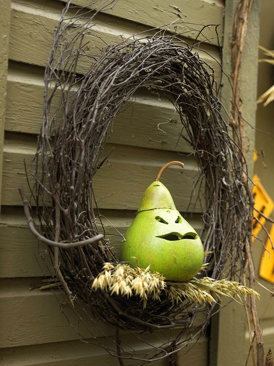 a creative twig wreath with a cutout pear and some wheat is a bold idea that looks unusual