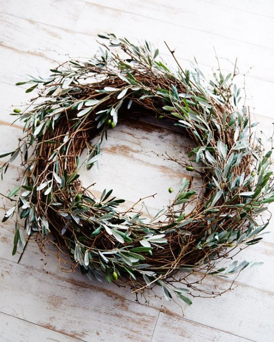 a relaxed fall twig wreath with much olive greenery and olives is all-natural and will give a Mediterranean feel to your porch