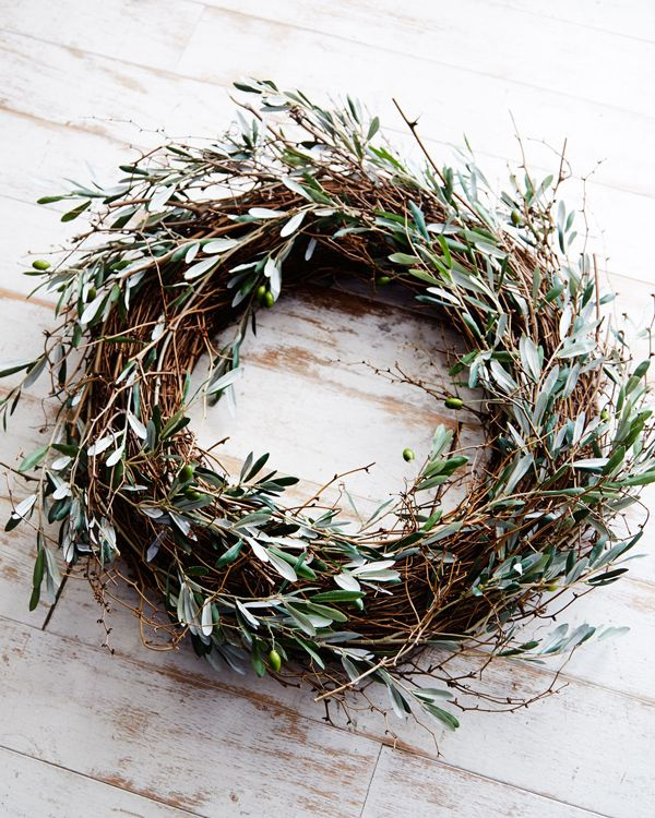 a relaxed fall twig wreath with much olive greenery and olives is all natural and will give a Mediterranean feel to your porch