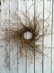 such a twig textural wreath will be a nice solution for Halloween, it's scary and bold