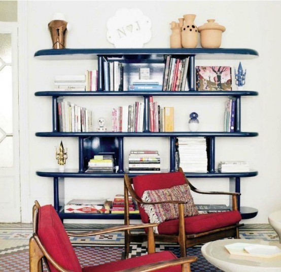 a mid-century modern book case made of shiny navy blue panels will add color to your room