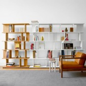 a catchy color block mid-century modenr bookcase done in white and neutral wood features a lot of storage space