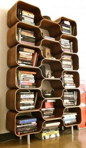 a very catchy plywood bookcase that resembles a beehive looks truly mid-century modern and bold