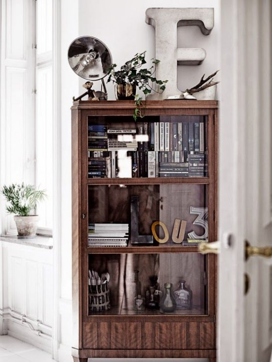 a mid-century modern wooden bookcase with glass covered compartments looks rather lightweight and you won't need to dust the shelves every time