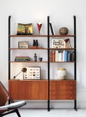 a mid-century modern bookcase of metal and rich-stained wooden shelves and drawers is a stylish idea that doesn't take any floor space