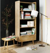a light-colored wooden bookcase with open shelves is a very chic idea that doesn't catch an eye too much
