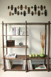 a very simple dark-colored wood bookcase with open shelves will fit most of spaces easily