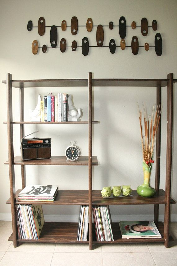 a very simple dark colored wood bookcase with open shelves will fit most of spaces easily