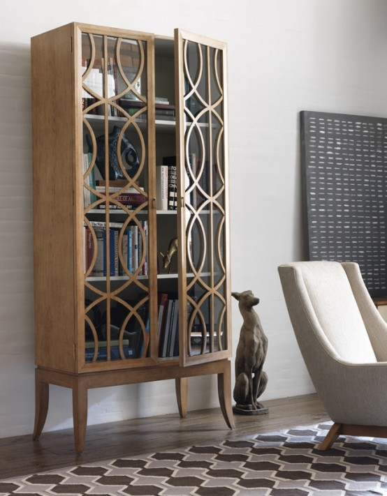 a chic and elegant wooden bookcase with tall legs and patterns made with wood on glass doors