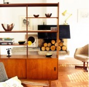 a bright shaded wooden mid-century modern bookcase with shelves and closed storage cabinets