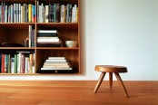 a wall-mounted light-colored wooden box bookcase is a stylish way to save floor space