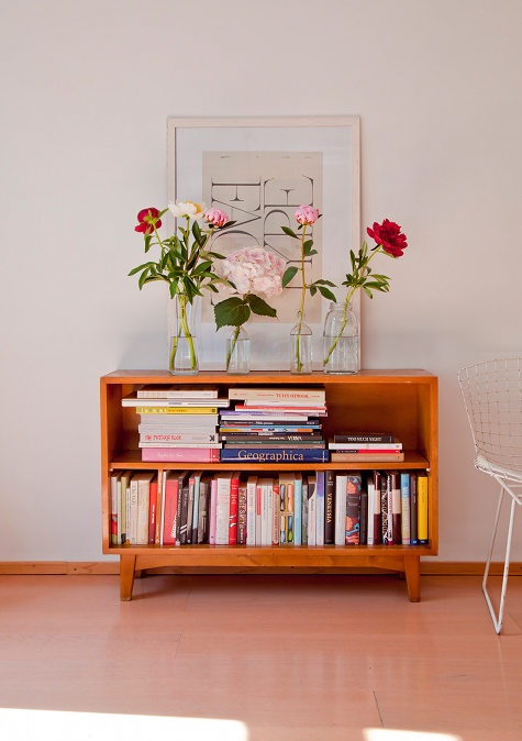 a bright orange wood low bookcase features no doors is a colorful touch to your space