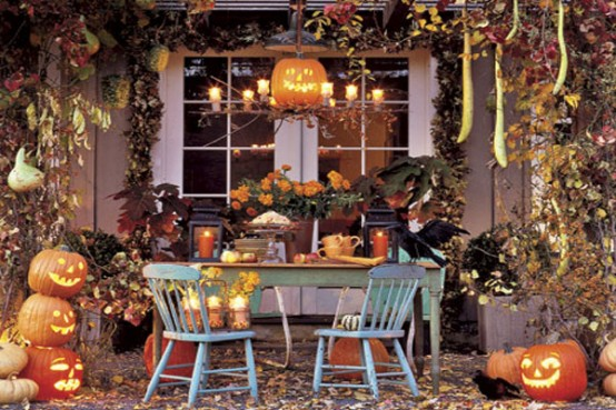 faux crows glowing jack o lanterns fall blooms and dried leaves are - Halloween Display Ideas