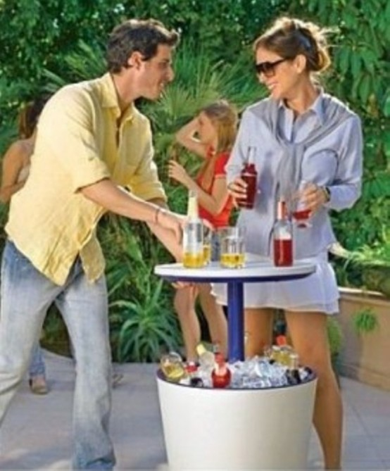 Outdoor Bar With A Table And A Fridge Under It 2 554x