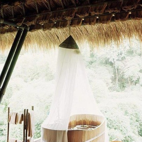 a wooden soak bath with a canopy on top is all you need for ultimate relaxation