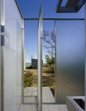 an ultra-modern outdoor shower completely done with frosted glass