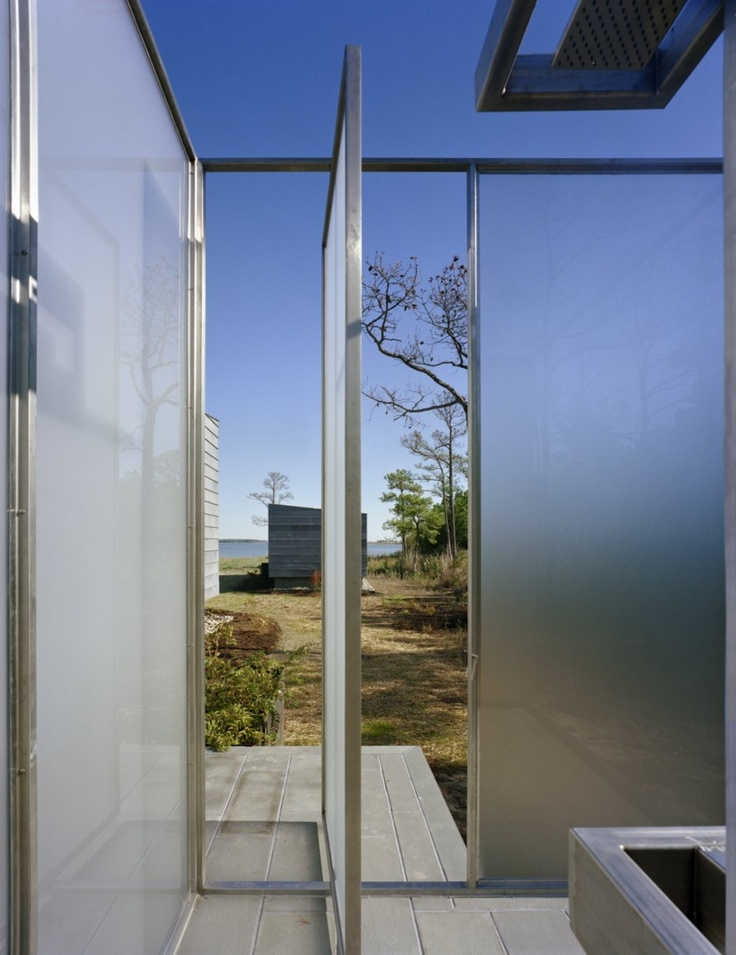 an ultra modern outdoor shower completely done with frosted glass
