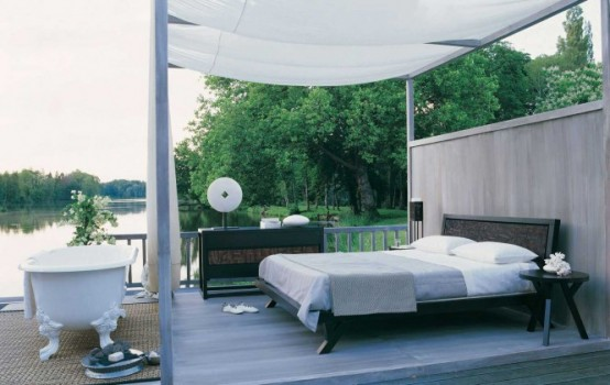 Outdoor Bedroom With A Bathtub