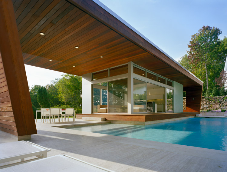 Outstanding swimming pool house design by hariri hariri for Simple houses design with swimming pool