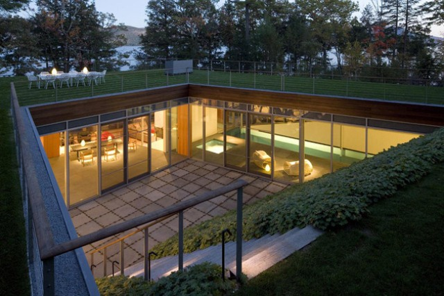 Partially Buried Lake House With Nature Let In