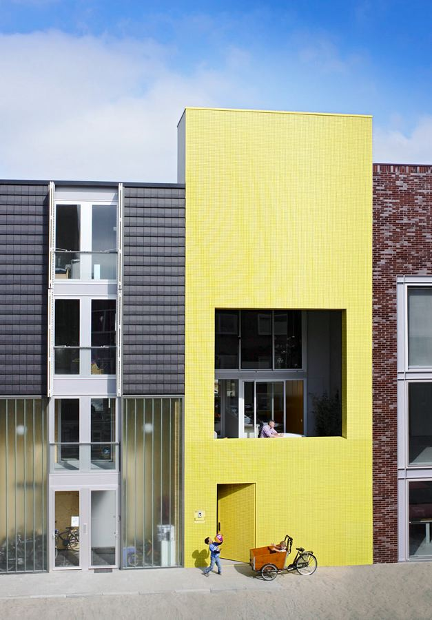 Patio House With The Bright Yellow Facade