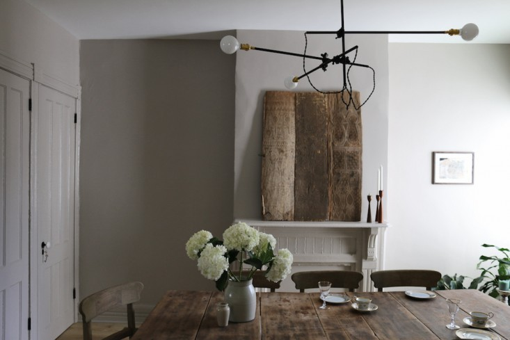 Peaceful Dining Room With Farmhouse Furniture And Industrial Lights
