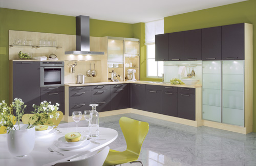 a colorful ktichen with lime green walls, dark grey cabinets, neutral touches and much light is bold