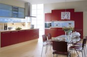 a bold red kitchen with neutral backsplashes and lots of lights plus catchy lamps is very cool