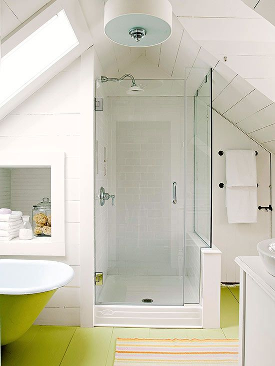 a white attic bathroom with a neon green floor, a shower, a neon green bathtub and a sink