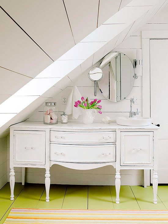 a vintage dresser turned into a whitewashed vanity will add a refined touch to the space