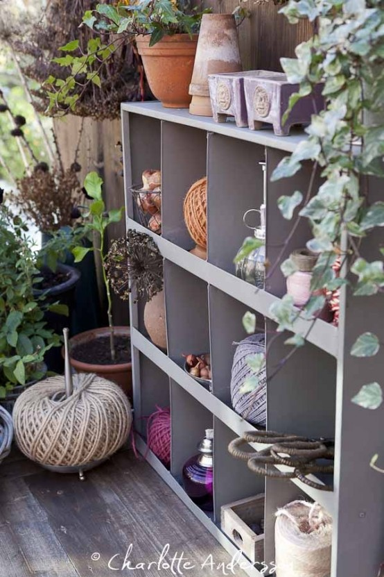 a grey metal shelving unit for storage is a cool idea for a balcony but it requires some space