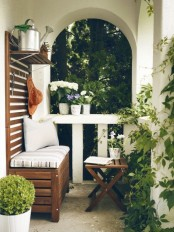 a bench with a storage space inside and a small shelf over it will fit even a tiny balcony