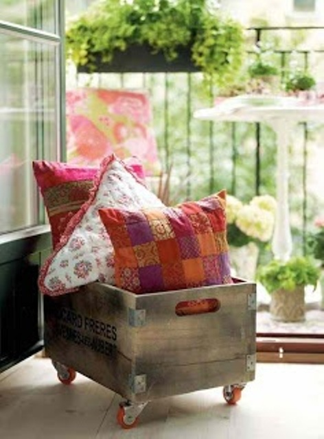 a crate on casters is great for storing pillows and other accessories and can be used anywhere