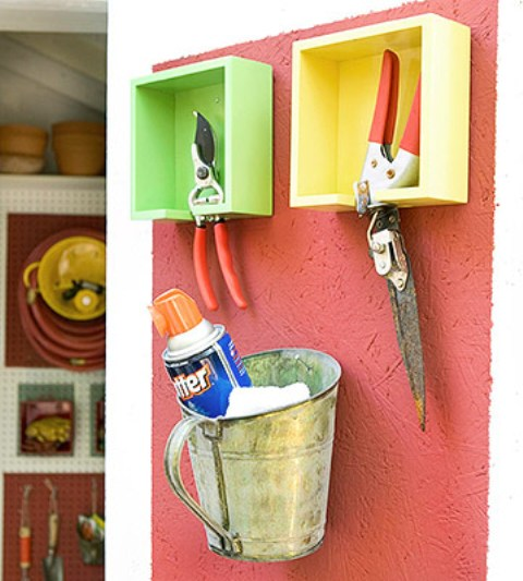 bright painted box shelves for tools and a metal bucket for storing are a creative idea for shed storage