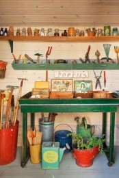 open shelves and a green table with open storage provide enough storage for everything you need