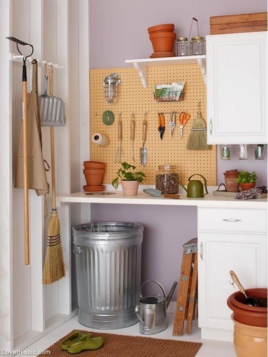 white cabinets to declutter and a pegboard for hanging some stuff you need often