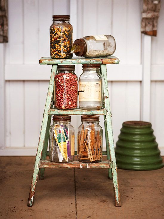 a simple vintage ladder can accommodate some stuff in jars or baskets and can be taken away when not in need