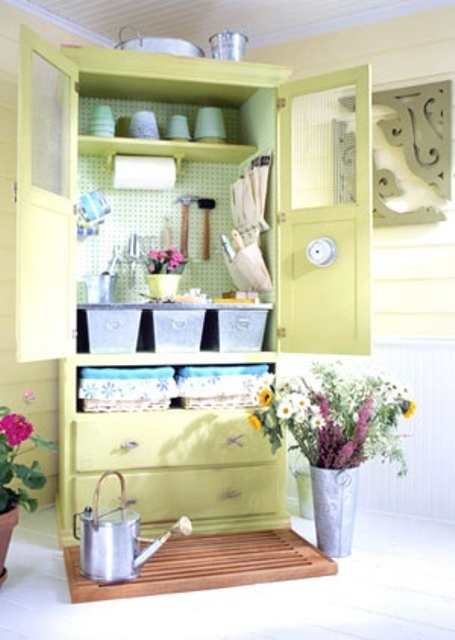 a vintage wardrobe renovated with bright paint will be a nice garden she storage unit, add pegboard inside, too