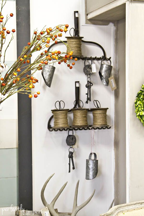 some rakes hung on the wall will let you store twine and tools you need