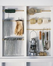 an open shelving unit with holders where you can hang various small stuff