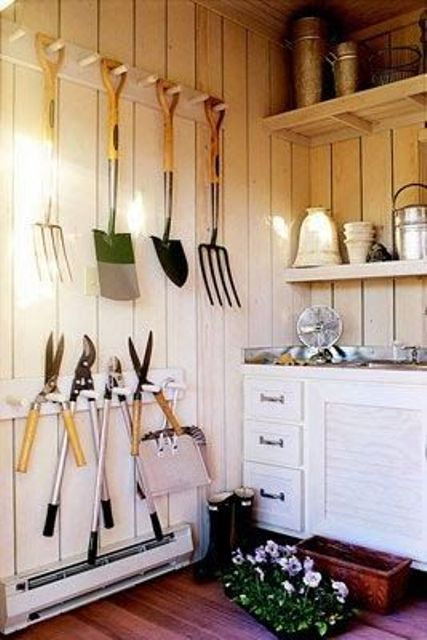 hooks on the wall next to your usual cabinets and shelves are a great and comfortable idea