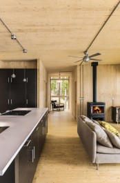 Prefab Lake Cottage With Unfinished Wooden Walls
