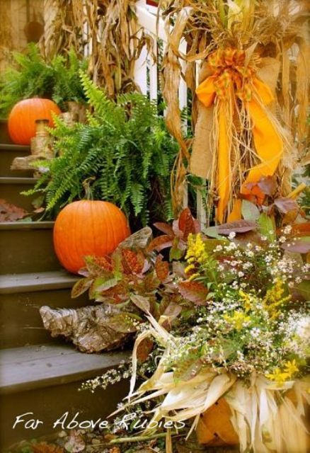 Mixing dried leaves and twigs with fresh greenery and pumpkins is an interesting idea to add some color to your porch's decor.