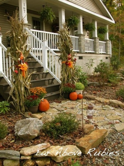 Tall corn stalks are definitely eye-catching as visitors approach the porch.
