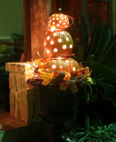 Pumpkins with lights inside works not only for Halloween but for overall Autumn's decor too.