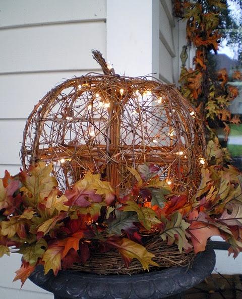 Make a DIY twig pumpkin with string lights inside.