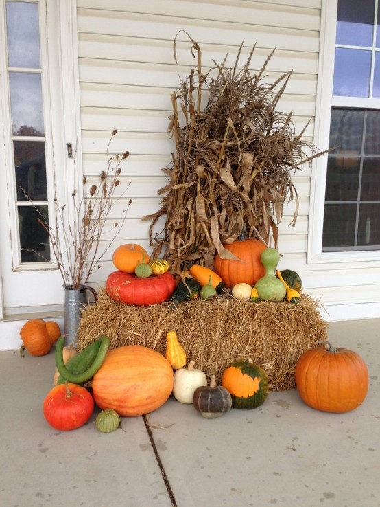Mixing pumpkins and gourds in different sizes and shapes work miracles when you're designing a centerpiece for your porch.
