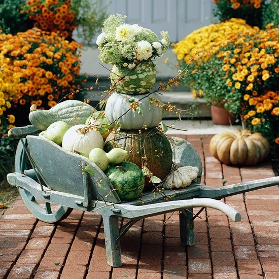Arrange a Fall pumpkin centerpiece close to your porch.