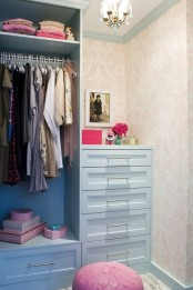 a pastel mini closet with blue built-in furniture, open and closed storage units, pink touches here and there