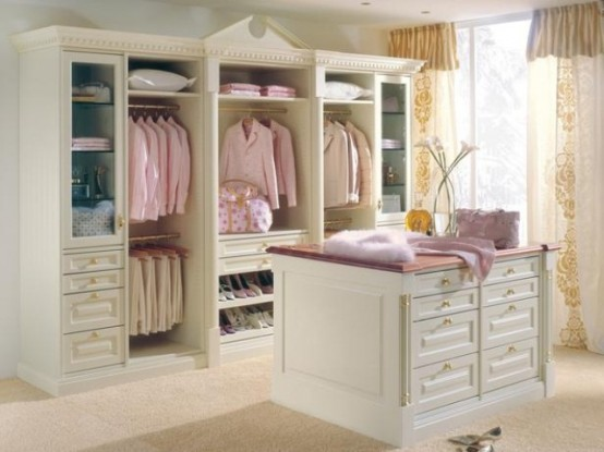 a simple feminine closet with an open and glass storage wardrobe, with drawers and a matching storage cabinets for small accessories and other stuff
